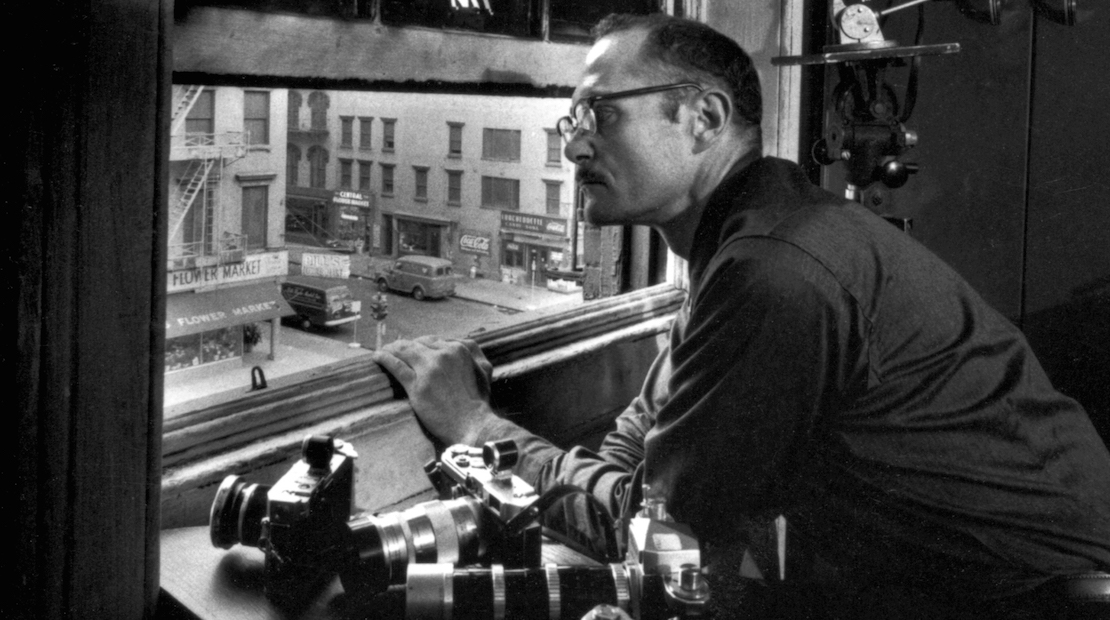 W. Eugene Smith looking out over Sixth Avenue.