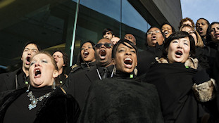 The Nathaniel Dett Chorale performs on the steps of the Canadian Embassy  overlooking the beginning of U.S.President Barack Obama's Inaugural parade. photo: © johnbeebe