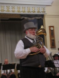 "Herb Poole, artistic director of the band; ""I love to play an instrument I can wear,"" says Herb."