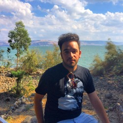 Ori Dagan on a recent trip to Israel at the Sea of Galilee, wearing his Thelonious Monk T-shirt. Dagan's  pastimes include seeing and hearing live music, shopping for used vinyl and posting fun videos on Instagram. He lives in downtown Toronto with his husband, filmmaker Leonardo Dell'Anno.