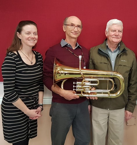 (from left) Donna Dupuy (concert band conductor); holding euphonium, Randy Kligerman (president, NHB Toronto); Bill Condon, who gifted the euphonium