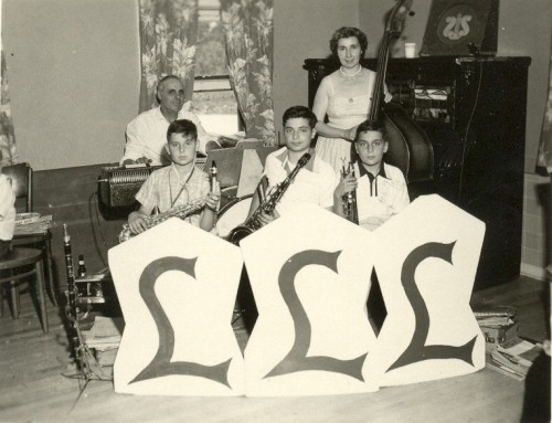 "LaBarbera family band, circa 1955. Joseph at the keyboard, Josephine on bass, with Joe, Pat, and John in the frontline. ""My mother learned bass because she felt left out of family events. She learned by putting a fingering chart above the kitchen sink and memorized the fingerings as she did the dishes. It was very unusual for a woman to be playing bass but my mother was ahead of her time and very independent before she met my father."""