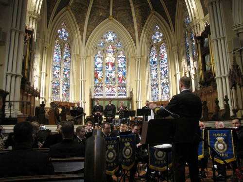 The combined bands of the naval reserve divisions of HMCS York (Toronto) and HMCS Star (Hamilton) in the Cathedral Church of St. James, Toronto. Photo Jack MacQuarrie