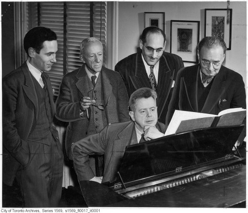 Ernest MacMillan at the piano with (left to right) Godfrey Ridout, Leo Smith, John Weinzweig and Healey Willan surrounding him, circa 1948. Photo credit NOTT AND MELL (CITY OF TORONTO ARCHIVES)