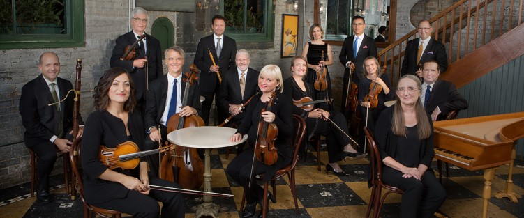 From left to right: Dominic Teresi, bassoon (seated); Elisa Citterio, violin (seated); Thomas Georgi, violin (standing, dark tie); Allen Whear, cello (seated); Marco Cera, oboe (standing); John Abberger, oboe (seated); Julia Wedman, violin (seated); Patricia Ahearn, violin (seated); Cristina Zacharias, violin (standing); Brandon Chui, viola (standing, blue tie); Geneviève Gilardeau, violin (seated); Patrick Jordan, viola (standing, yellow tie); Chris Verrette, violin (seated); Charlotte Nediger, harpsichord (seated). Photo by Cylla von Tiedemann