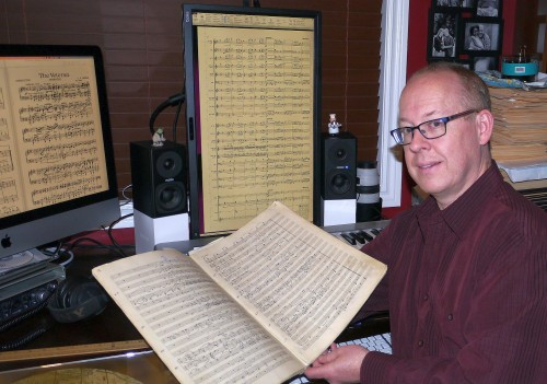 Trevor Wagler, Waterloo Concert Band director, with C.F. Thiele's score. Photo by Pauline Finch.