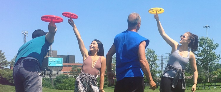 The cast of What Goes Up learning frisbee. Photo credit: Dahlia Katz