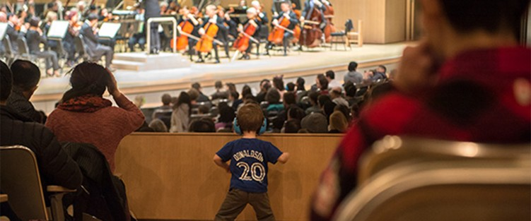 A young boy watches a relaxed performance at the TSO. Photo credit: Jag Gundu.