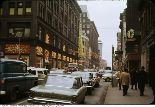 Simpsons, at left on Yonge Street, decorated for the Christmas holidays, December 1962. Photo by Ellis Wiley