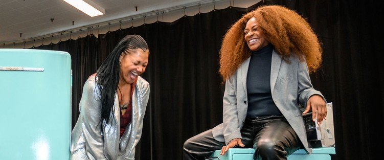 Sharing a laugh in the rehearsal hall – internationally renowned Canadian soprano Measha Brueggergosman (left) plays the virtuoso role of the Moon, a gorgeous maternal presence overseeing all, shining her light where the characters need to see, particularly Caroline, played by Jully Black (right). Photo by Dahlia Katz