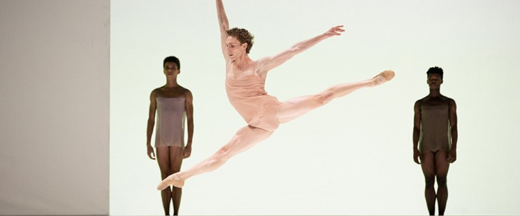 "Skylar Campbell with Alexander Skinner and Siphesihle November in Chroma, part of The National Ballet of Canada's ""Modern Masterpieces"" series. Photo by KAROLINA KURAS"