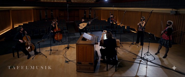 Still from Tafelmusik's Il Seicento, February 18. L-R: Keiran Campbell (cello), Pippa Macmillan (violone), Lucas Harris (theorbo and guitar), Brandon Chui (viola), Elisa Citterio (violin), Patricia Ahern (violin) and Christopher Bagan (harpsichord and organ).