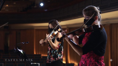 Still from Tafelmusik's Il Seicento, February 18: violinists Elisa Citterio (L) and Patricia Ahern.
