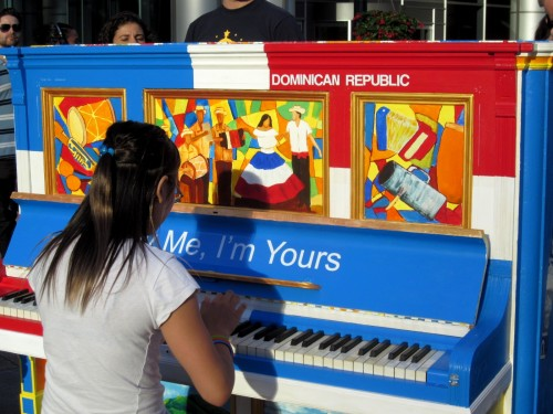 July 2012: Toronto's Play Me I'm Yours installation, inspired by Luke Jerram, was the brainchild of the creative arts director for the 2015 Pan Am games, Don Shipley. 41 street pianos, each decorated to reflect a country participating in the games, were unleashed in places like Pearson airport, Union Station, on the Toronto Island Ferry and city parks, squares and streets. Photo credit THEKATANDTHEFALLINGLEAVES